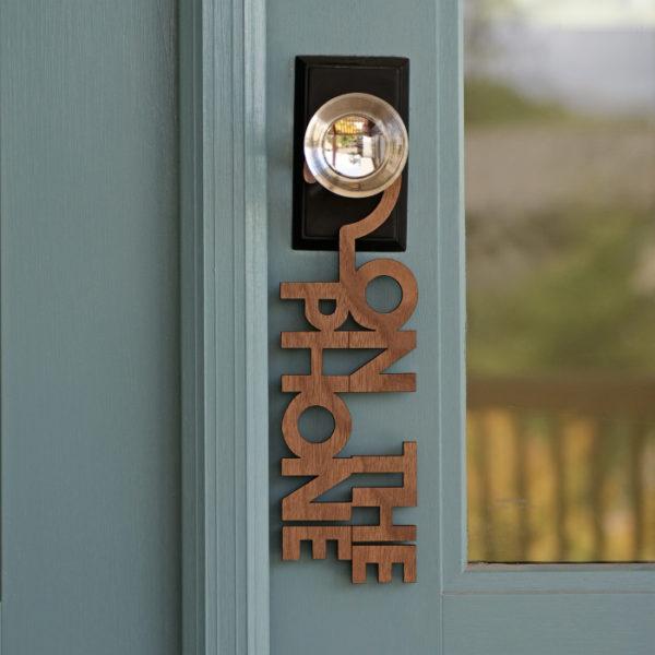 on the phone door sign